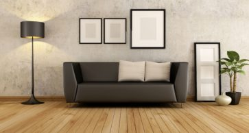 Brown couch with cushion against old wall in a living room - rendering